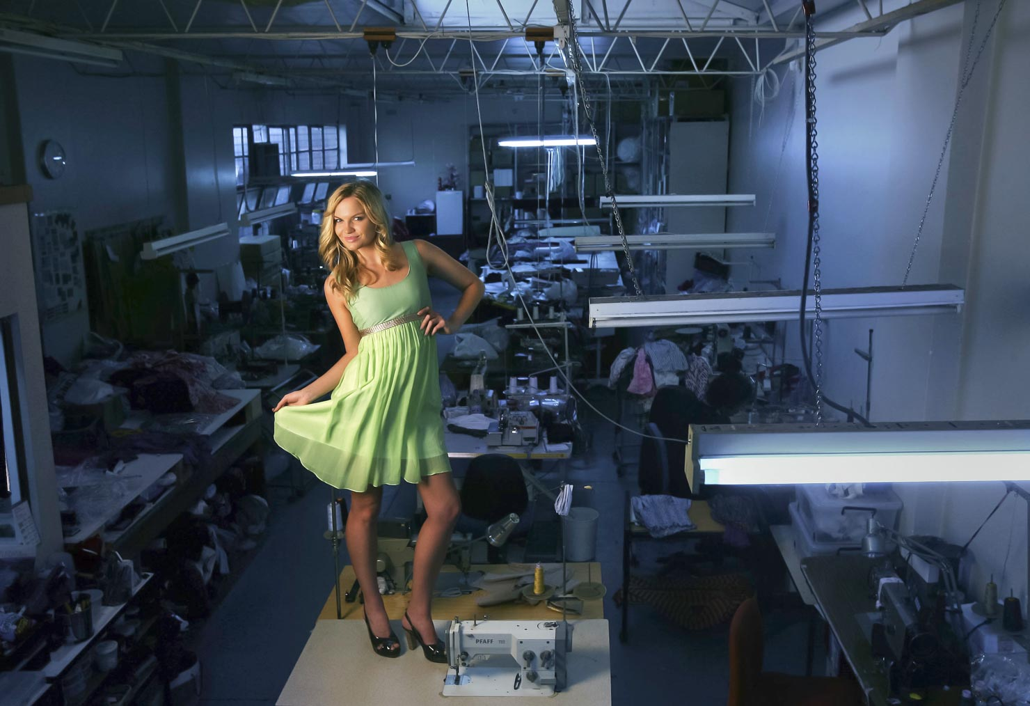 Model Ally Parry in an Amar dress in the factory where the dress was made