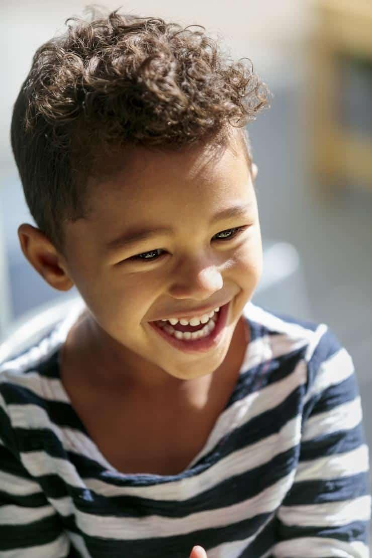 Boy smiling at kindergarten childcare