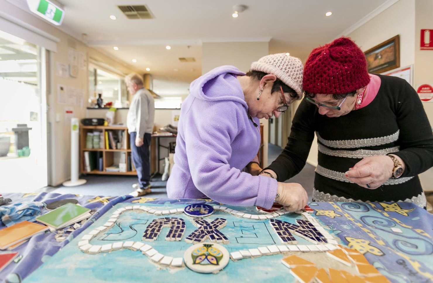 Elderley, aged care, women making mosaics