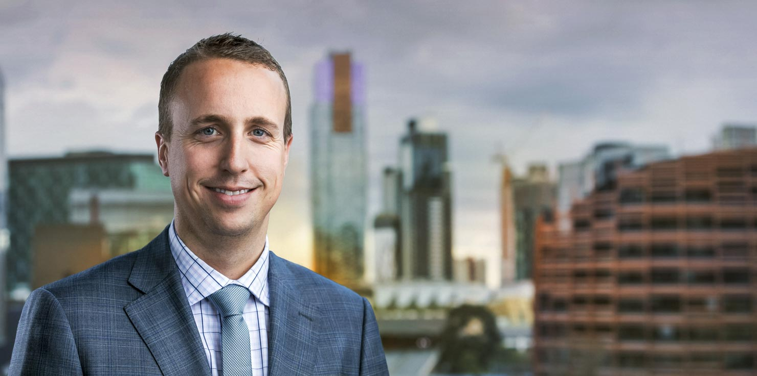 Corporate portrait with city backdrop