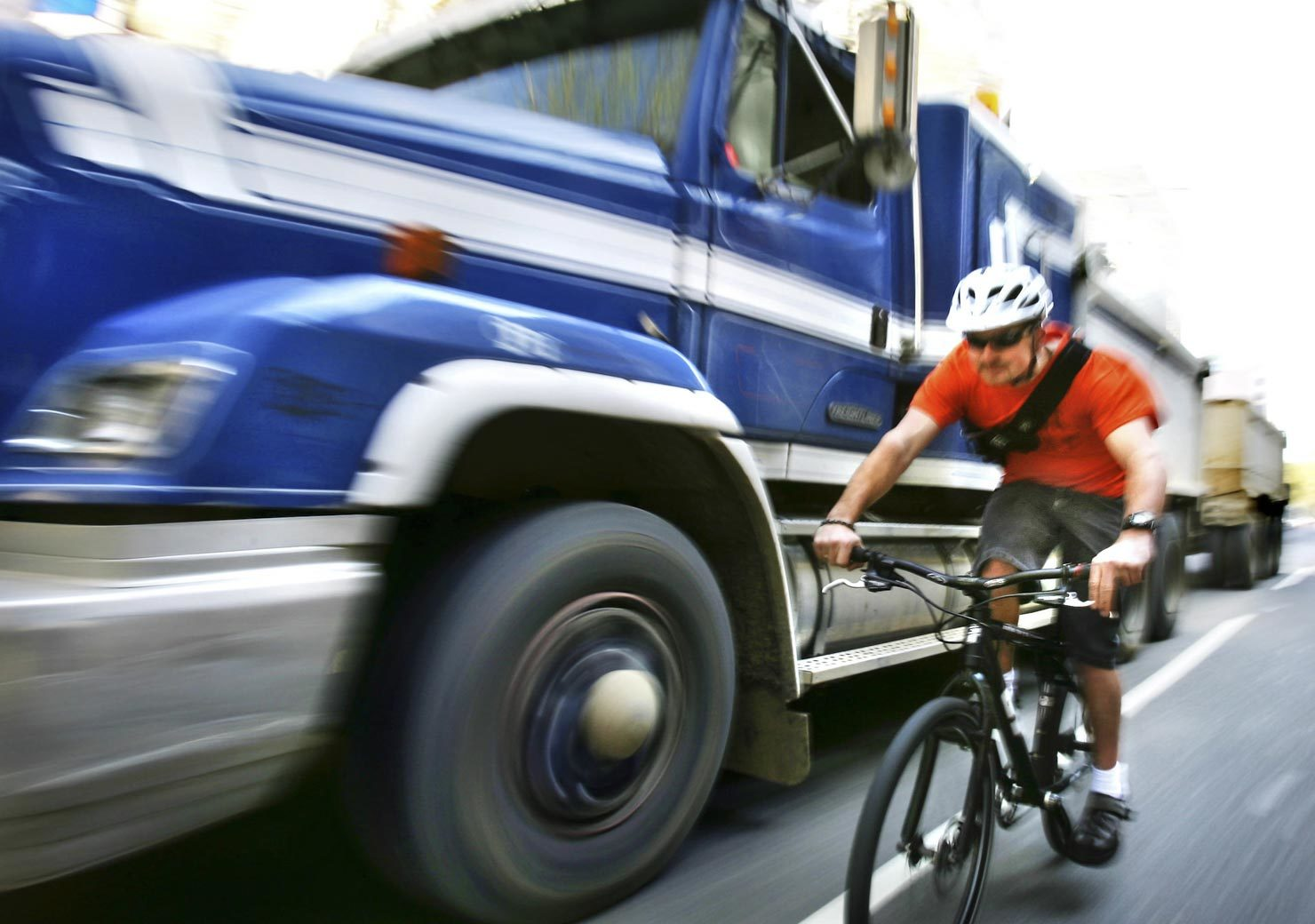 Cyclist being overtaken dangerously be a truck