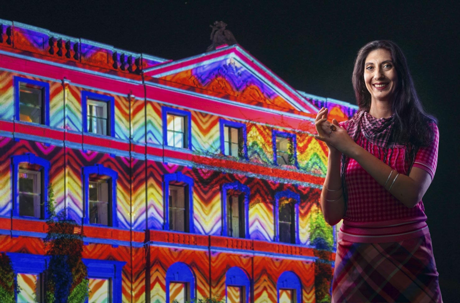 Projectionist with building & projected colours