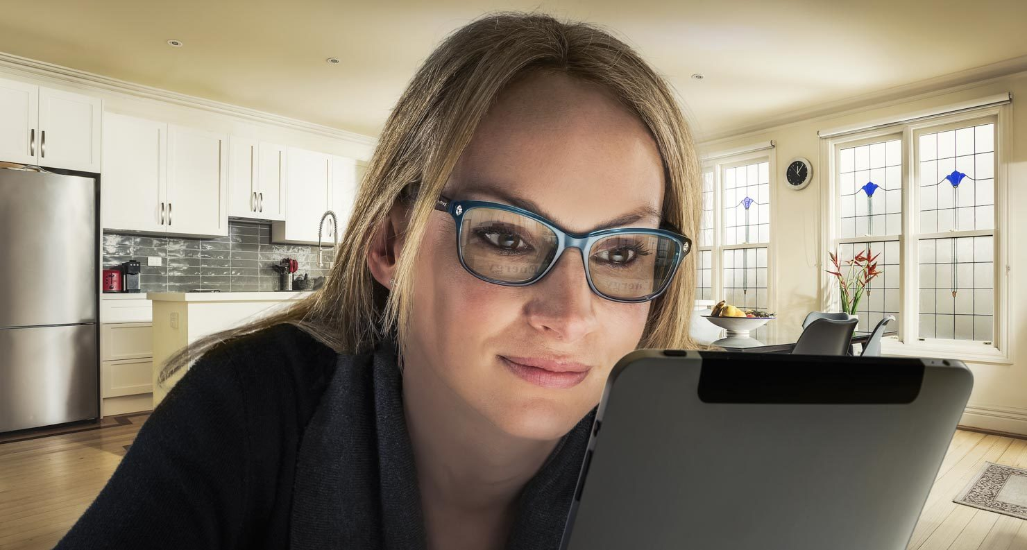 Lady with iPad in Kitchen
