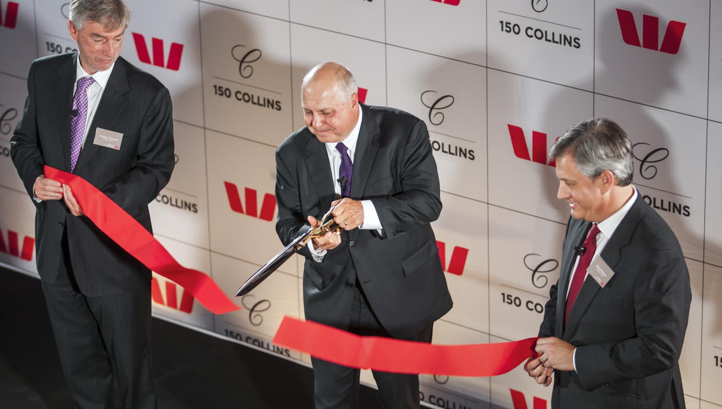 Executive cuts ribbon at Westpac launch event