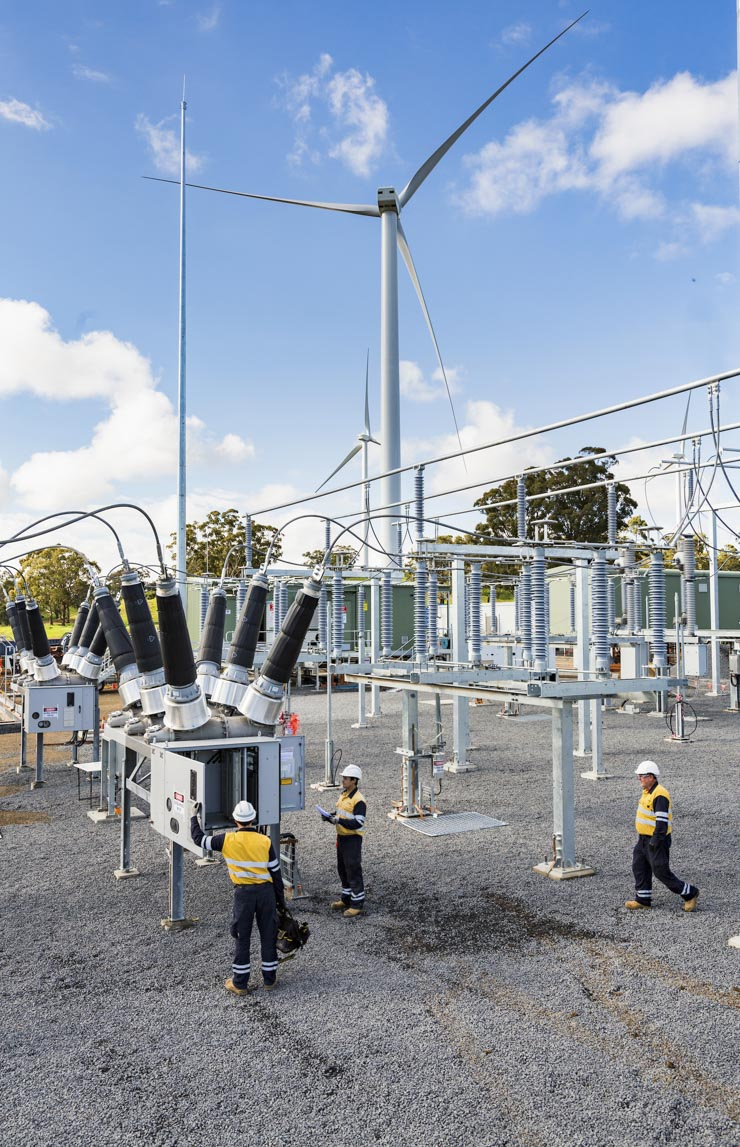 Workers at an electricity sub-station
