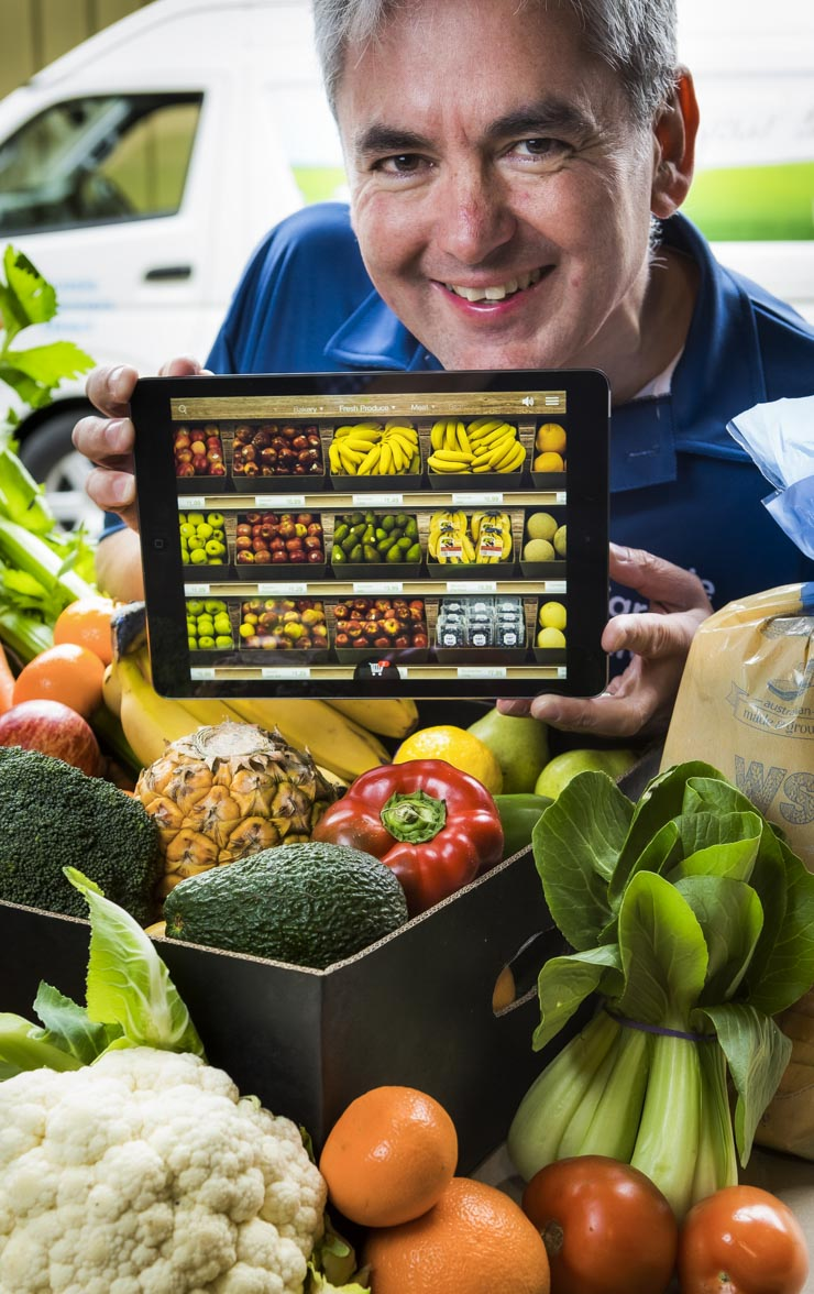 Man with iPad app with fruit & vegetables