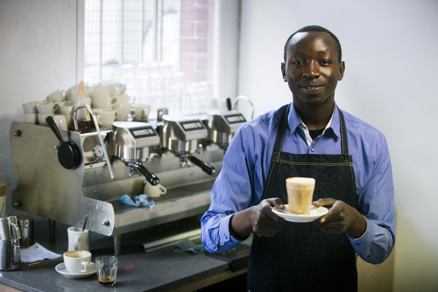 A Sudanese Barista making coffee at a cafe. Client: Brotherhood of St Laurence