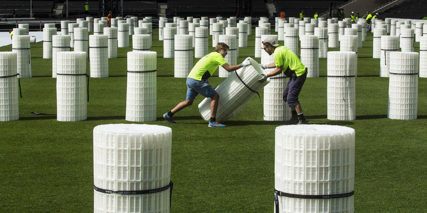 Roadies rolling out event flooring at AAMI Stadium