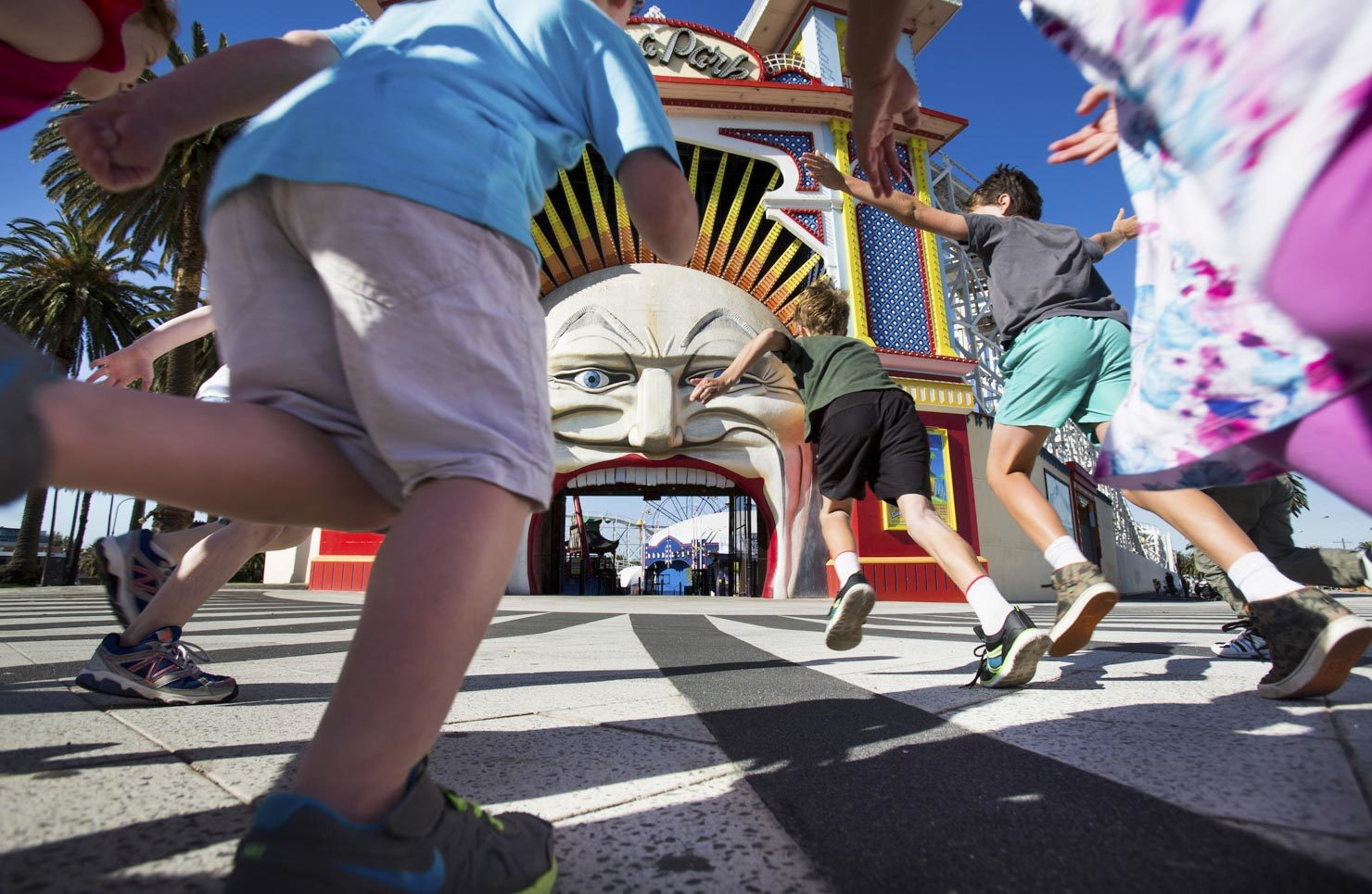 Kids run for the entrance of Luna Park
