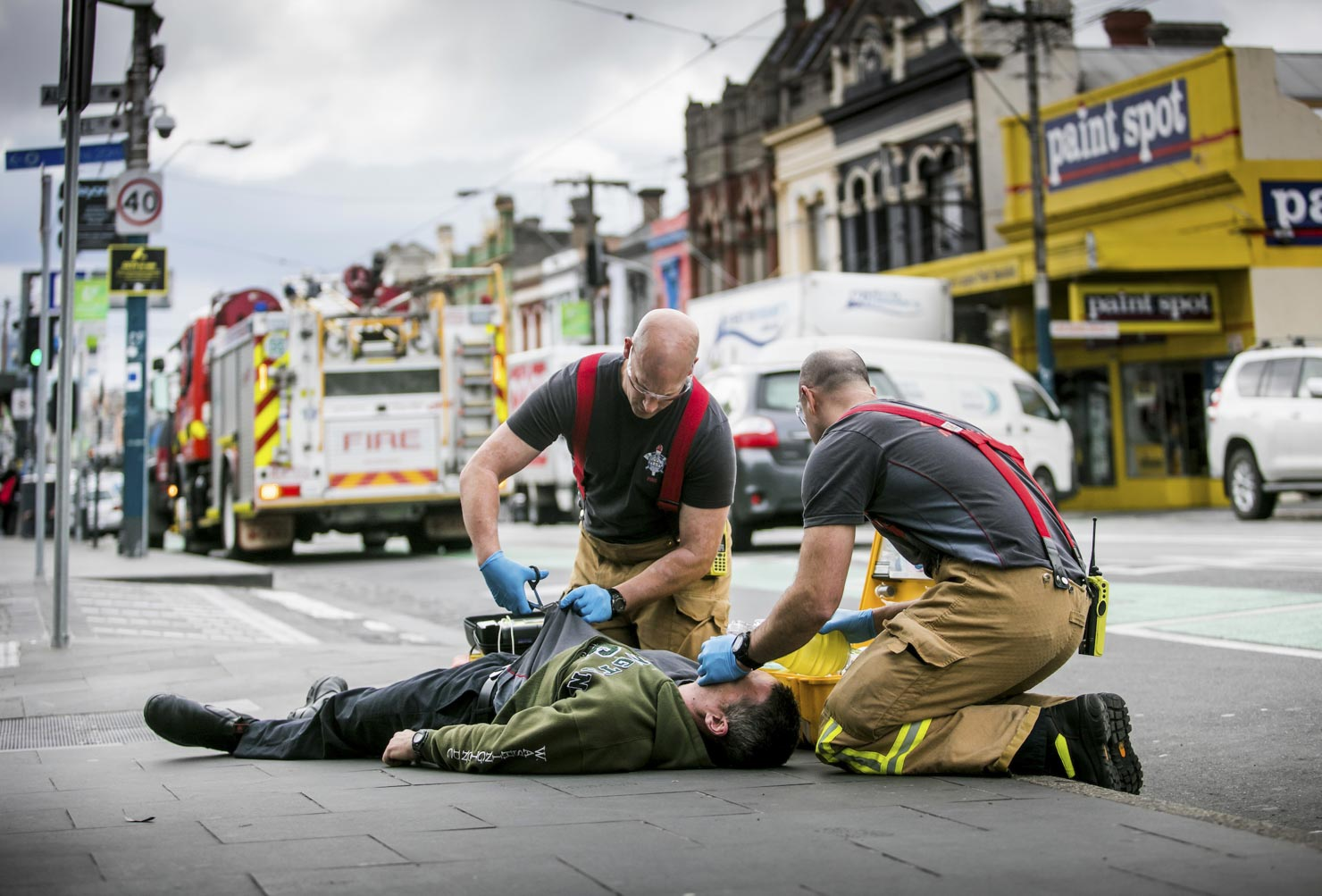 Melbourne Fire Brigade officers work with a man who was overcome by smoke