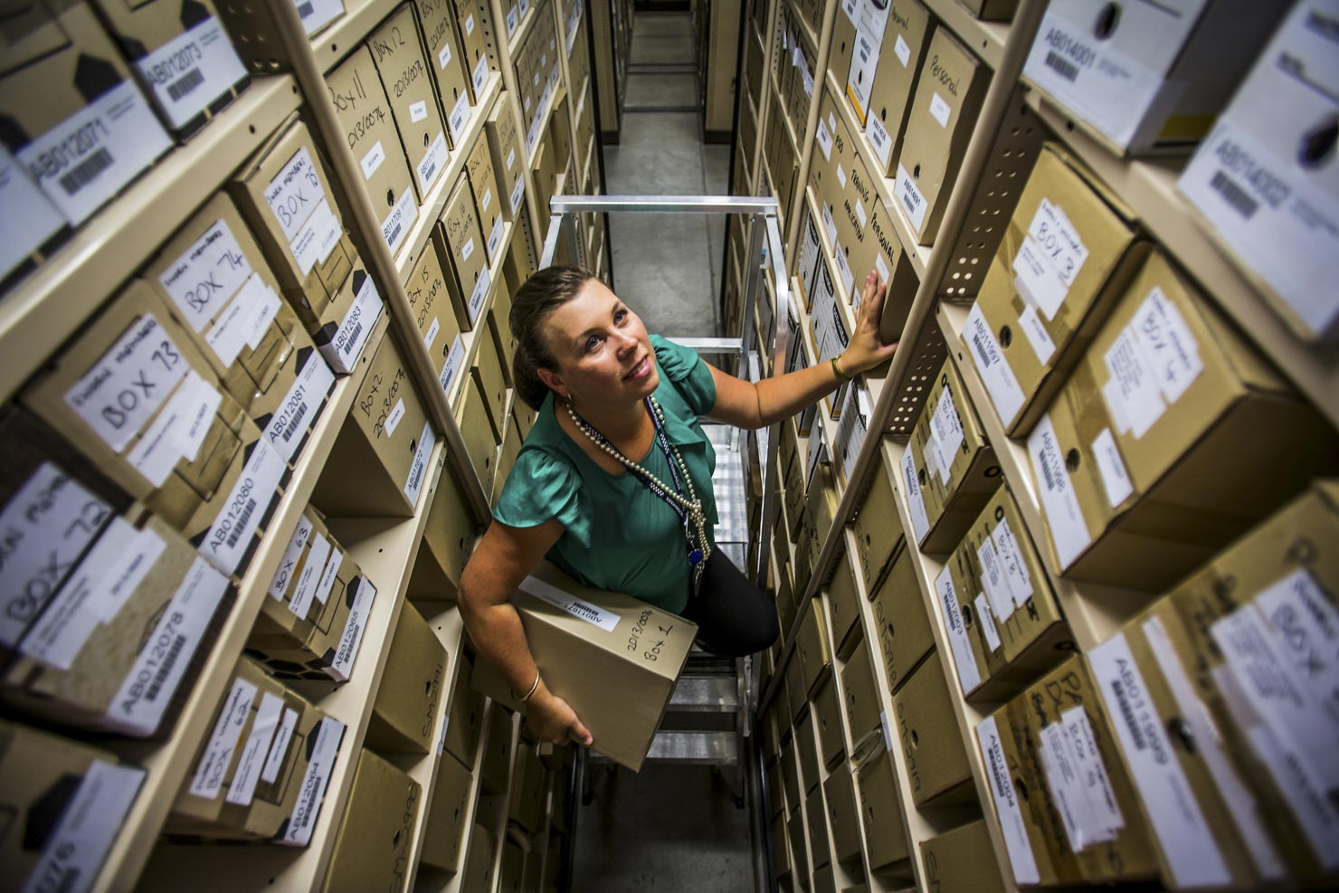 A worker with document archives
