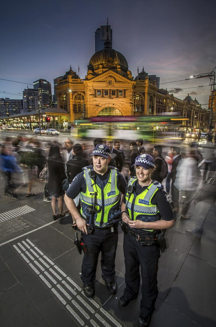 Victoria Police members patrolling at Flinders Street Station