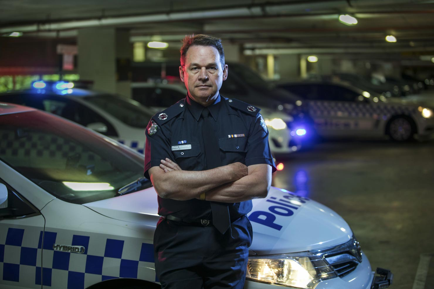 Victoria Police officer with police cars