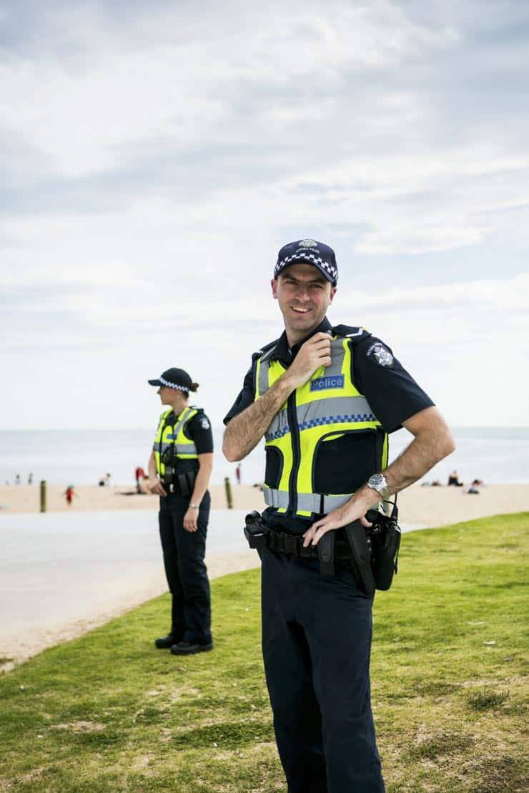 Victoria Police members patrol a beach