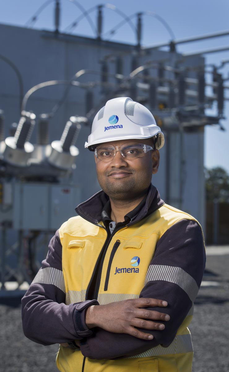 Jemena electrical trades worker at a power sub station